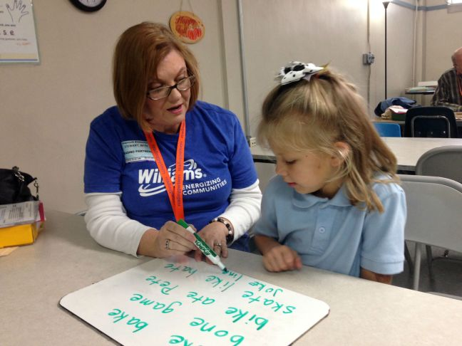 Beth Stewart volunteers an hour each week to help Hayden, a first grader at Sequoyah Elementary, improve her reading skills. Most students show dramatic improvement – many a grade year or more – after participating for a school year in Reading Partners.